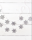 """<p> While you're crafting this glittery snowflake garland, make a few extras—they make great ornaments and gift toppers, too. </p><p><a href=""""https://abeautifulmess.com/diy-holiday-garlands-5-ways/"""" rel=""""nofollow noopener"""" target=""""_blank"""" data-ylk=""""slk:Get the tutorial."""" class=""""link rapid-noclick-resp"""">Get the tutorial.</a></p><p><a class=""""link rapid-noclick-resp"""" href=""""https://www.amazon.com/Sulyn-SUL51121-oz-Glitter-Jar/dp/B0090B8K8O?tag=syn-yahoo-20&ascsubtag=%5Bartid%7C10072.g.37499128%5Bsrc%7Cyahoo-us"""" rel=""""nofollow noopener"""" target=""""_blank"""" data-ylk=""""slk:SHOP GLITTER"""">SHOP GLITTER</a></p>"""