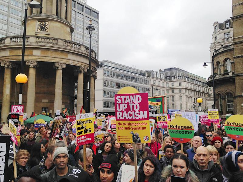 Protesters arrived at Portland Place in Central London at around midday holding banners adorning defiant messages of solidarity: Zakariya Cochrane