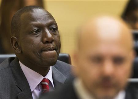 Kenya's Deputy President William Ruto reacts in courtroom before trial at the International Criminal Court in The Hague