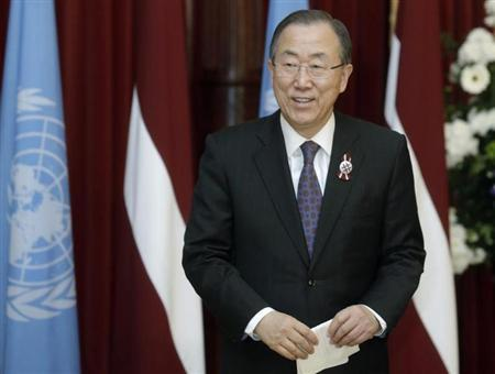 U.N. Secretary-General Ban smiles after a news conference in Riga