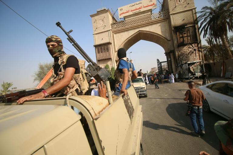 "Iraqi special forces patrol in a street in Basra on September 8, 2018, after Iraq's Joint Operations Command vowed a ""severe"" response with ""exceptional security measures"", including a ban on protests and group travel"