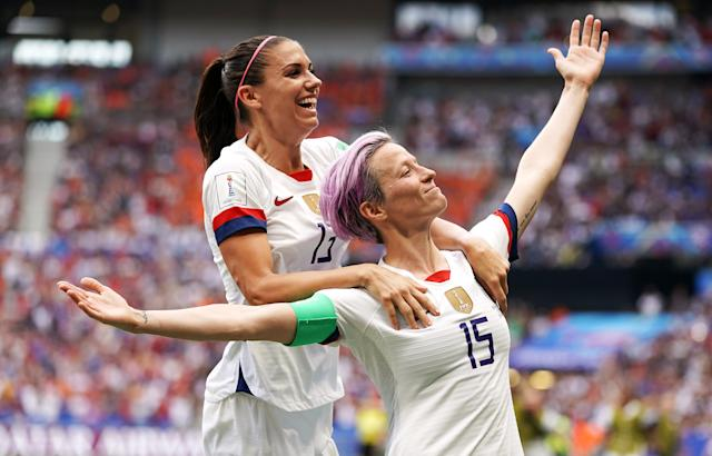 World Cup golden ball winner Megan Rapinoe, right, celebrates with Alex Morgan after scoring the opening goal during the women's World Cup final. The United States won the competition for the fourth time following a 2-0 victory over the Netherlands in Lyon. Veteran winger Rapinoe and Morgan finished the tournament as joint top scorers, alongside England's Ellen White, with six goals each (PA Wire)