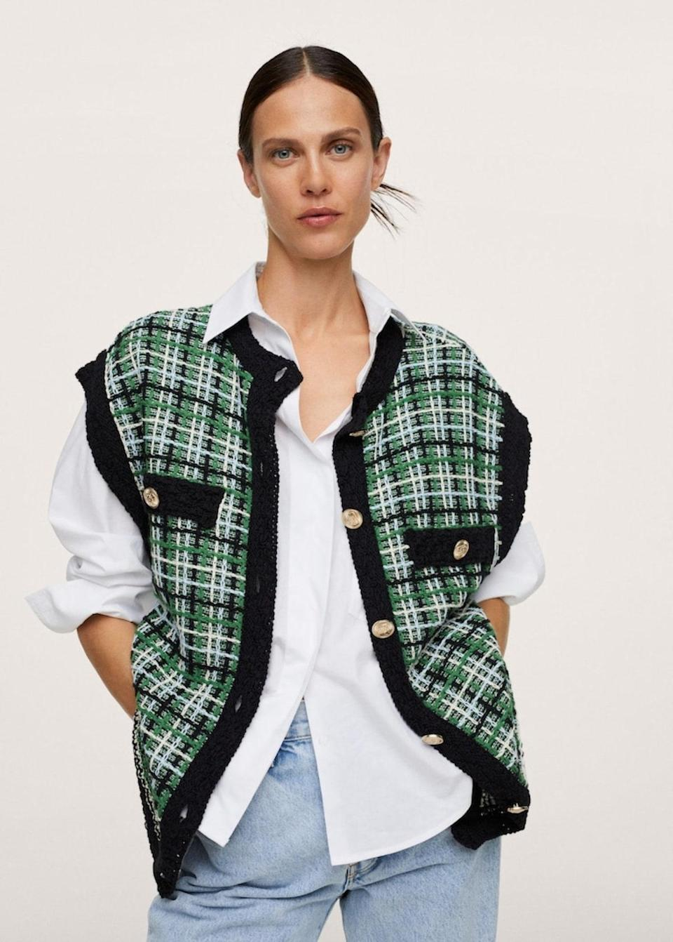 """There's something about a tweed <a href=""""https://www.glamour.com/gallery/sweater-vests-for-women?mbid=synd_yahoo_rss"""" rel=""""nofollow noopener"""" target=""""_blank"""" data-ylk=""""slk:sweater vest"""" class=""""link rapid-noclick-resp"""">sweater vest</a> layered over a <a href=""""https://www.glamour.com/gallery/best-white-button-down-shirts-women?mbid=synd_yahoo_rss"""" rel=""""nofollow noopener"""" target=""""_blank"""" data-ylk=""""slk:white button-down"""" class=""""link rapid-noclick-resp"""">white button-down</a> that looks downright <em>cool</em>. $100, Mango. <a href=""""https://shop.mango.com/us/women/cardigans-and-sweaters-cardigans/tweed-oversize-vest_17044060.html"""" rel=""""nofollow noopener"""" target=""""_blank"""" data-ylk=""""slk:Get it now!"""" class=""""link rapid-noclick-resp"""">Get it now!</a>"""