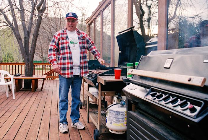 McCain barbecues at the McCain family ranch, near Sedona, in March 2000. (Photo by David Hume Kennerly/Getty Images)