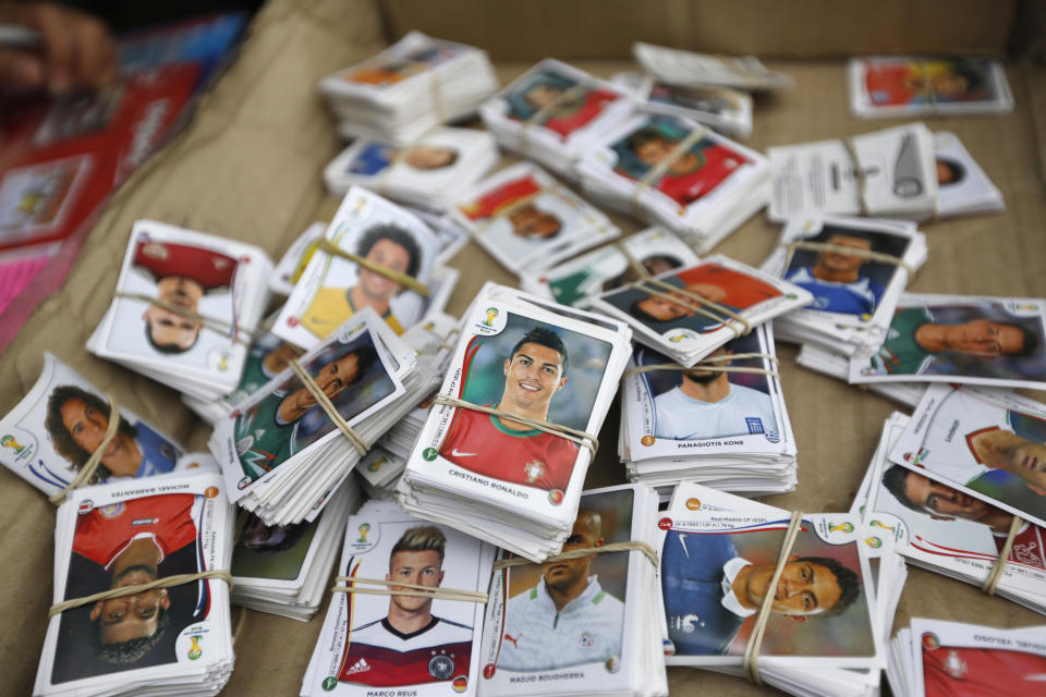 Stickers from the official 2014 FIFA World Cup sticker album are grouped to be exchanged between collectors along a street in Lima, May 1, 2014. The official 2014 FIFA World Cup sticker album is sold in 120 countries across the world, according to the publisher Panini. REUTERS/Mariana Bazo (PERU - Tags: SPORT SOCCER WORLD CUP SOCIETY)