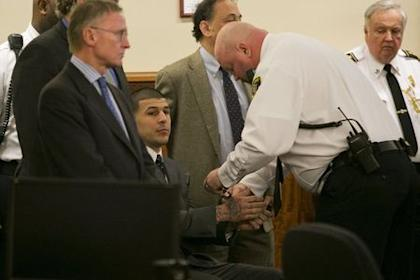 A court officer places handcuffs on Aaron Hernandez after the guilty verdict was read. (REUTERS)