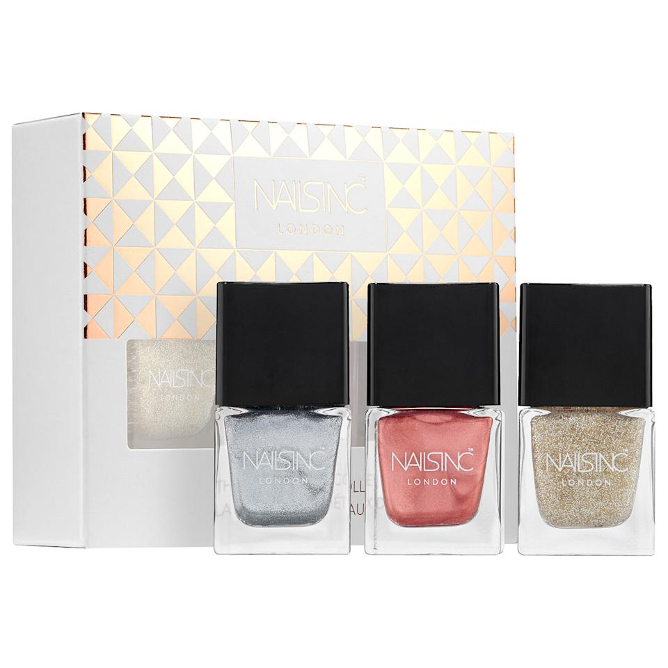 "<p>Thanks to this trio of heavy metal nail polishes, all future #ManiMondays will be a hit for those on your list.</p> <p>$19 | <a rel=""nofollow"" href='http://click.linksynergy.com/fs-bin/click?id=93xLBvPhAeE&subid=0&offerid=429865.1&type=10&tmpid=719&RD_PARM1=http%253A%252F%252Fwww.sephora.com%252Fthe-soft-metals-nail-polish-collection-P413513%253FskuId%253D1881549%2526icid2%253Dproducts%252520grid%253Ap413513&u1=ISELglitterbeautygifts'>SHOP IT</a></p>"