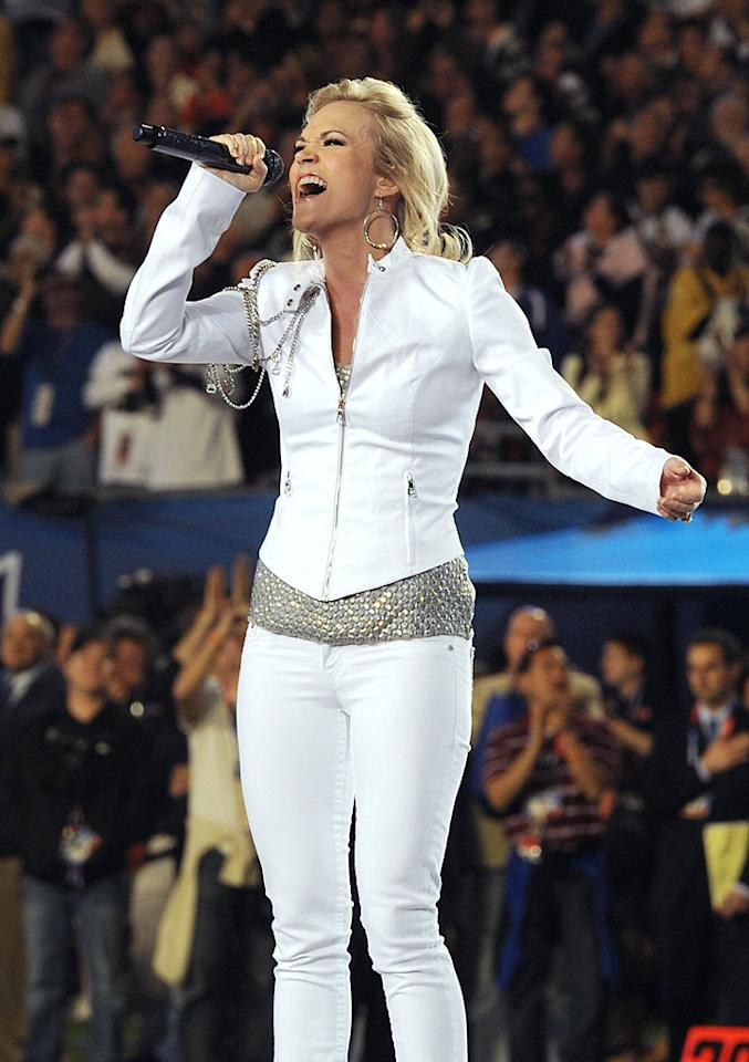 "Carrie Underwood belted out the ""Star-Spangled Banner"" in a questionable white pantsuit. What did you think of her performance? Gustavo Caballero/<a href=""http://www.gettyimages.com/"" target=""new"">GettyImages.com</a> - February 7, 2010"