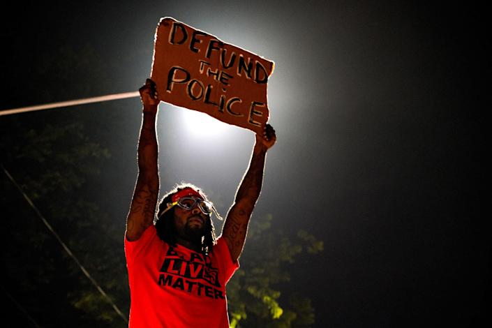 """Demonstrators gather for a protest after an Atlanta police officer shot and killed Rayshard Brooks, 27, at a Wendy's fast food restaurant drive-thru in Atlanta, on June 14, 2020.<span class=""""copyright"""">Ben Hendren—Anadolu Agency/Getty Images</span>"""