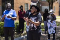 Faya Toure, center, cheers for voting rights at the John Lewis Advancement Act Day of Action, a voter education and engagement event, Saturday, May 8, 2021, in front of Brown Chapel A.M.E. Church in Selma, Ala. (AP Photo/Vasha Hunt)