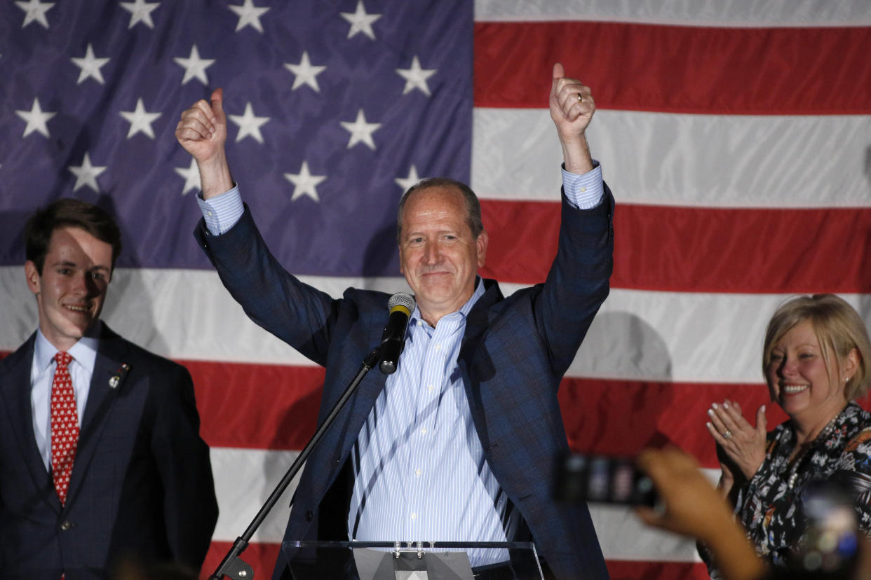 North Carolina Ninth District Republican congressional candidate Dan Bishop celebrates his victory in Monroe, N.C., with his son, Jack, and wife, Jo. (Photo: Nell Redmond/AP)