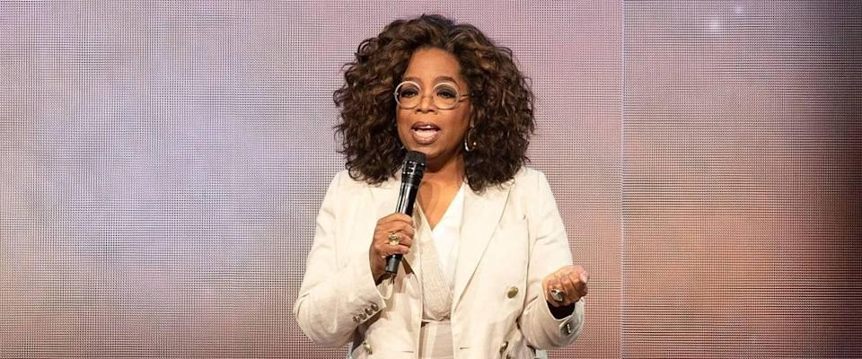 Oprah Winfrey on stage talking into microphone