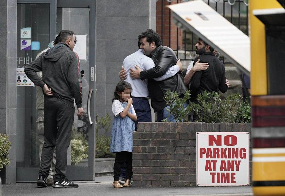 People leave the Sheffield Metropolitan Hotel, where a five-year-old Afghan refugee died after he fell from a window (Peter Byrne/PA) (PA Wire)