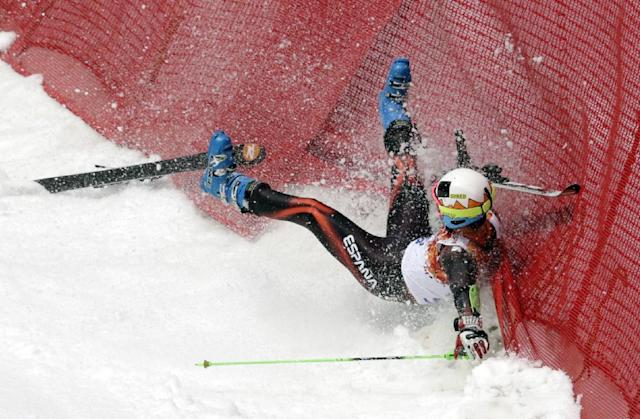 Spain's Alex Puente Tasias crashes during the first run of the men's giant slalom the Sochi 2014 Winter Olympics, Wednesday, Feb. 19, 2014, in Krasnaya Polyana, Russia. (AP Photo/Charles Krupa)