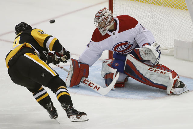 Montreal Canadiens goaltender Carey Price (31) stops s penalty shot by Pittsburgh Penguins' Derick Brassard during the first period of an NHL hockey game in Pittsburgh, Wednesday, March 21, 2018. (AP Photo/Gene J. Puskar)