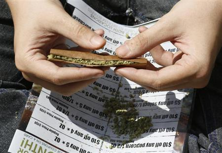 A participant rolls a marijuana filled blunt at the 4/20 marijuana holiday in Civic Center Park in downtown Denver April 20, 2013. REUTERS/Rick Wilking