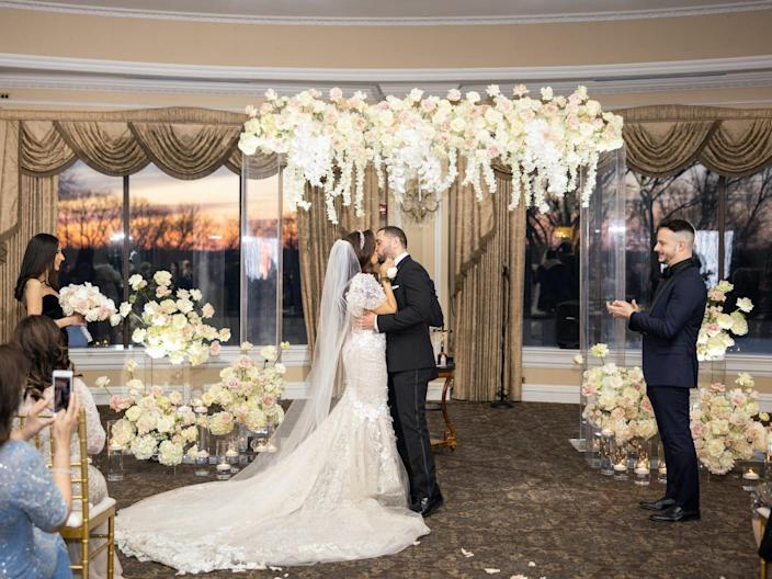 Vishnell and her husband kiss during their wedding ceremony