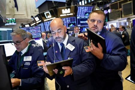 Wall Street gets boost from easing trade concerns, euro zone stimulus