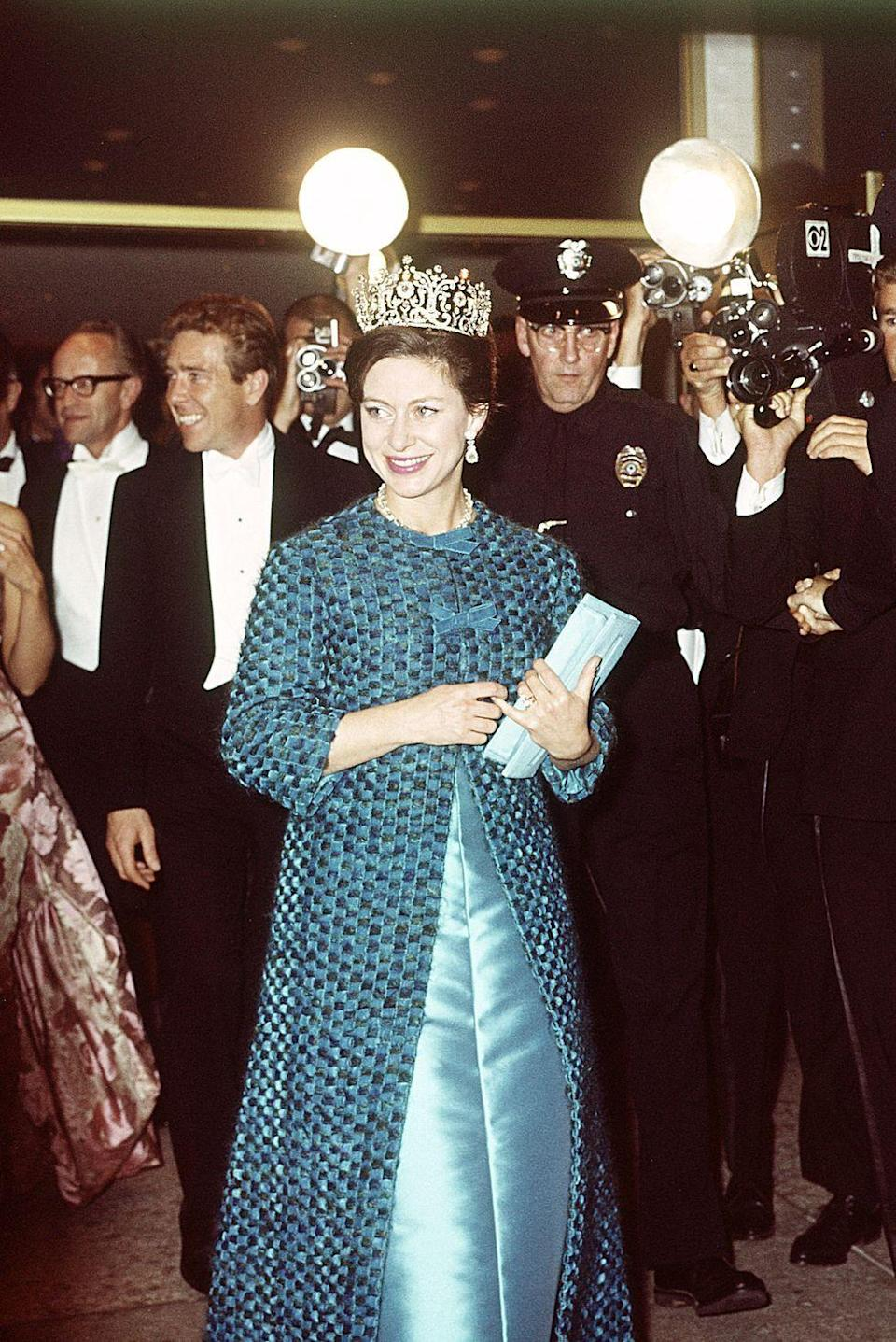 <p>In 1965, Princess Margaret wore a blue dress and coat with a stunning tiara during a visit to America. The Princess attended an event at the Hollywood Palladium in Los Angeles with Lord Snowdon.</p>