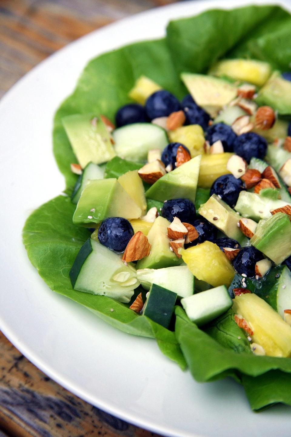 "<p>Top this refreshing salad with your favorite protein, such as grilled chicken, salmon, or tofu for a light, refreshing, and filling meal.</p> <p><strong>Calories:</strong> 340<br> <strong>Protein:</strong> 6.3 grams</p> <p><strong>Get the recipe:</strong> <a href=""https://www.popsugar.com/fitness/Flat-Belly-Salad-35067945"" class=""link rapid-noclick-resp"" rel=""nofollow noopener"" target=""_blank"" data-ylk=""slk:sweet and tropical salad"">sweet and tropical salad</a></p>"