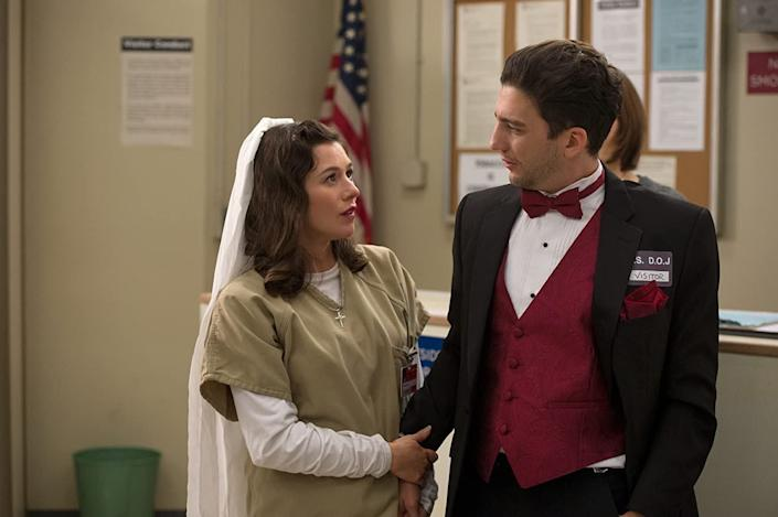 "Magaro with Yael Stone in an episode of ""Orange Is the New Black."" He appeared in 11 episodes of the popular Netflix series. (Photo: Netflix)"
