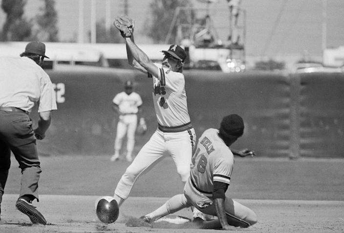 "Angels second baseman Bobby Grich catches a throw in front of Baltimore Orioles baserunner Pat Kelly during a game in 1979. <span class=""copyright"">(Associated Press)</span>"