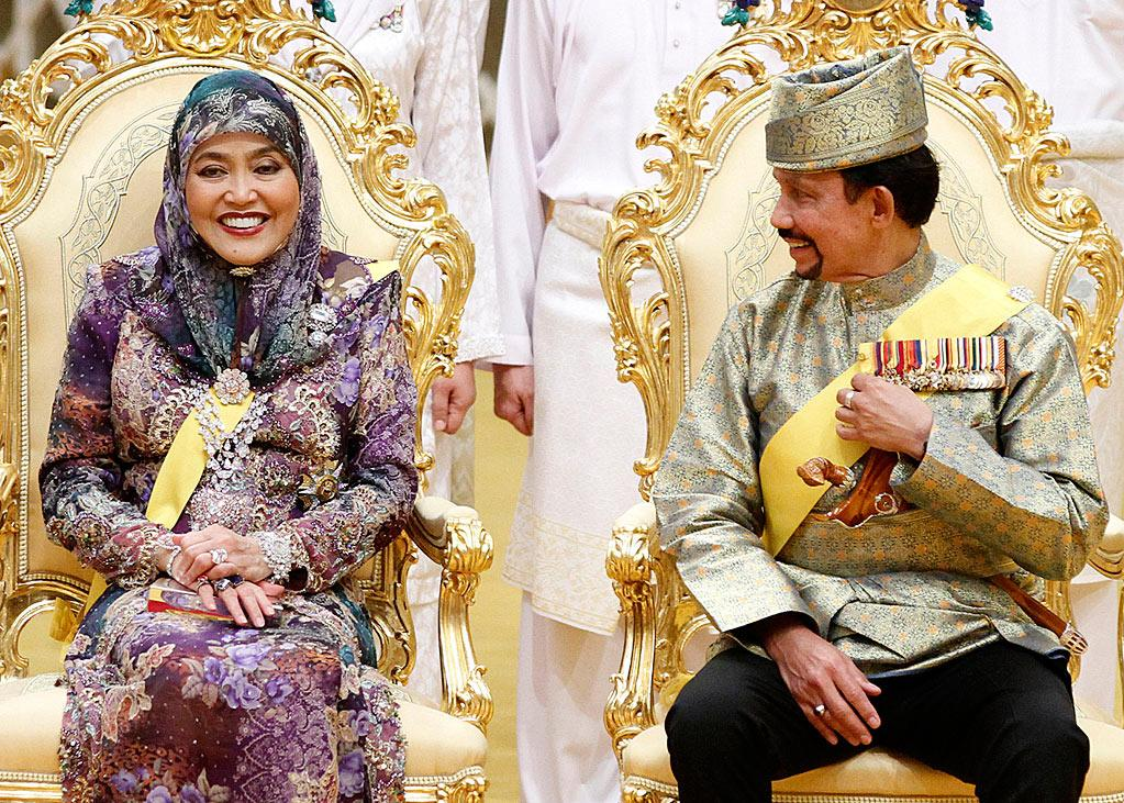 "<div class=""caption-credit""> Photo by: Wenn.com</div><div class=""caption-title""></div>The Sultan and his wife look happy. With 12 children from three wives and at least one already married, the Sultan, 66, may be looking forward to a day when he'll be done hosting weddings. This week's affair, despite being by no means budget, did away with a traditional procession through the capital in an open gilded Rolls Royce that was costly in terms of crowd control and security. <br>"