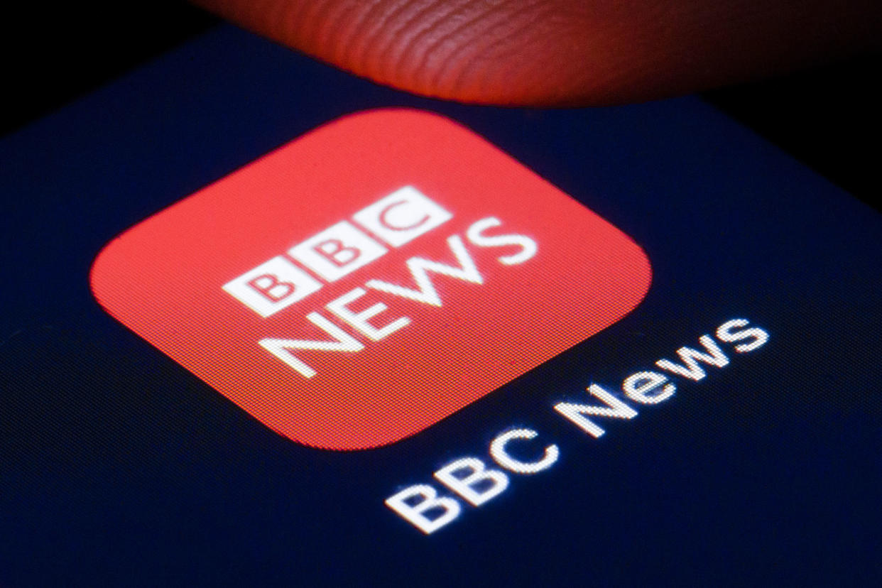 BERLIN, GERMANY - APRIL 22: The logo of BBC News, the 24/7 television news channel of the BBC, is shown on the display of a smartphone on April 22, 2020 in Berlin, Germany. (Photo by Thomas Trutschel/Photothek via Getty Images)