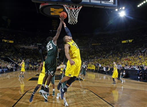 Michigan State forward Draymond Green (23) and Michigan forward Jordan Morgan (52) reach for a rebound in the first half of an NCAA college basketball game, Tuesday, Jan. 17, 2012, at Crisler Center in Ann Arbor, Mich. (AP Photo/Tony Ding)