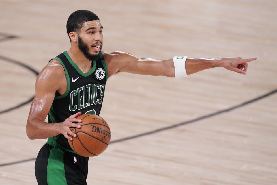 Boston Celtics' Jayson Tatum (0) directs a play during the second half of an NBA conference final playoff basketball game against the Miami Heat Friday, Sept. 25, 2020, in Lake Buena Vista, Fla. (AP Photo/Mark J. Terrill)