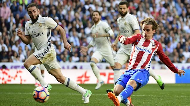 BARCELONA, Spain (AP) - Antoine Griezmann's late goal gave Atletico Madrid a 1-1 draw at Real Madrid on Saturday, tightening the title race in the Spanish league.