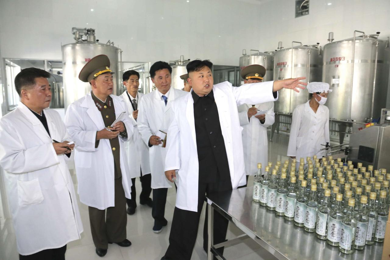 North Korean leader Kim Jong Un (2nd R) gives field guidance to the Ryongmun Liquor Factory in this undated photo released by North Korea's Korean Central News Agency (KCNA) in Pyongyang May 28, 2014. REUTERS/KCNA (NORTH KOREA - Tags: POLITICS) ATTENTION EDITORS - THIS PICTURE WAS PROVIDED BY A THIRD PARTY. REUTERS IS UNABLE TO INDEPENDENTLY VERIFY THE AUTHENTICITY, CONTENT, LOCATION OR DATE OF THIS IMAGE. FOR EDITORIAL USE ONLY. NOT FOR SALE FOR MARKETING OR ADVERTISING CAMPAIGNS. THIS PICTURE IS DISTRIBUTED EXACTLY AS RECEIVED BY REUTERS, AS A SERVICE TO CLIENTS. NO THIRD PARTY SALES. NOT FOR USE BY REUTERS THIRD PARTY DISTRIBUTORS. SOUTH KOREA OUT. NO COMMERCIAL OR EDITORIAL SALES IN SOUTH KOREA