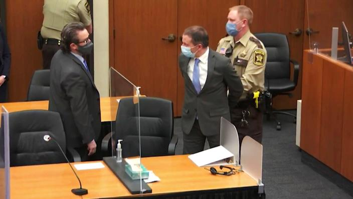 <p>In this image from video, former Minneapolis police Officer Derek Chauvin, center, is taken into custody as his attorney, Eric Nelson, left, looks on, after the verdicts were read at Chauvin's trial for the 2020 death of George Floyd, Tuesday, April 20, 2021, at the Hennepin County Courthouse in Minneapolis, Minn.</p> (Court TV via AP, Pool))