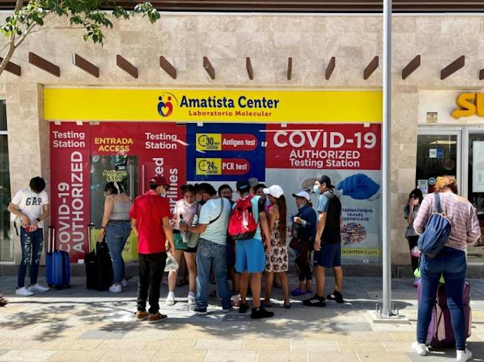 People queue for a Covid-19 test in Playa del Carmen on Mexico's Caribbean coast