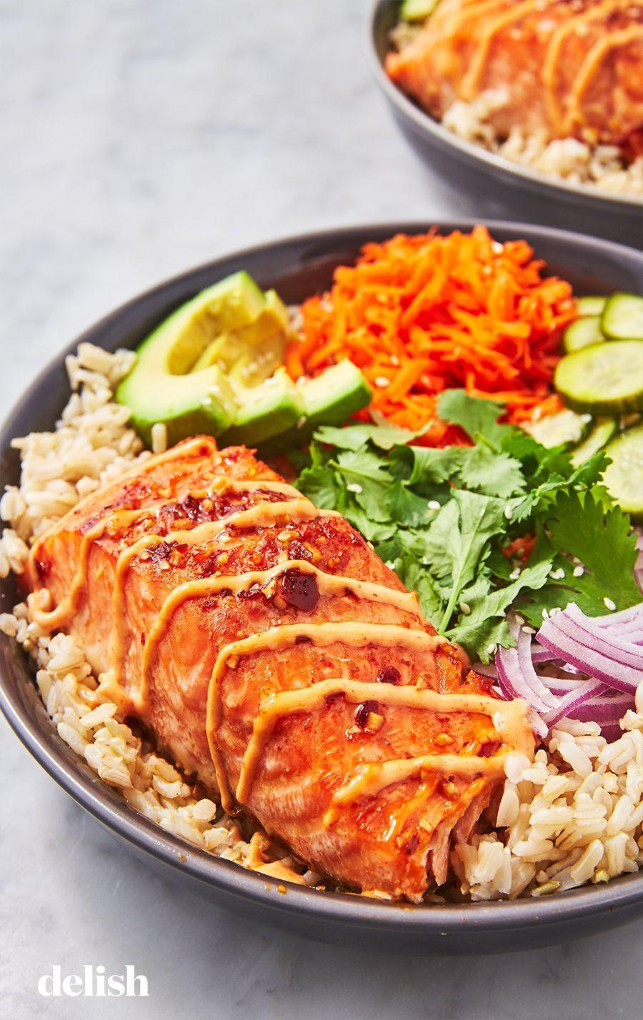 "<p>Skip the take-out sushi and make this instead!</p><p>Get the recipe from <a href=""https://www.delish.com/cooking/recipe-ideas/a26950912/spicy-salmon-bowl-recipe/"" rel=""nofollow noopener"" target=""_blank"" data-ylk=""slk:Delish"" class=""link rapid-noclick-resp"">Delish</a>.</p>"