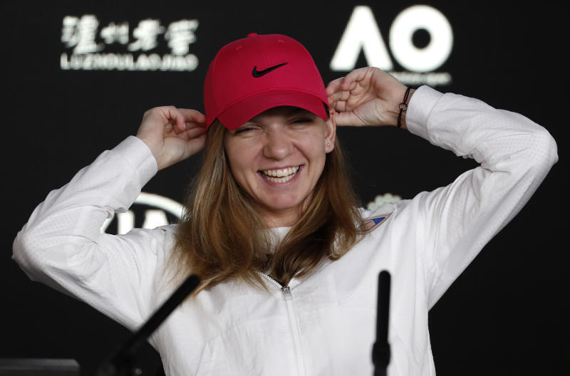 Romania's Simona Halep smiles during a press at the Australian Open tennis championships in Melbourne, Australia, Saturday, Jan. 12, 2019. (AP Photo/Kin Cheung)