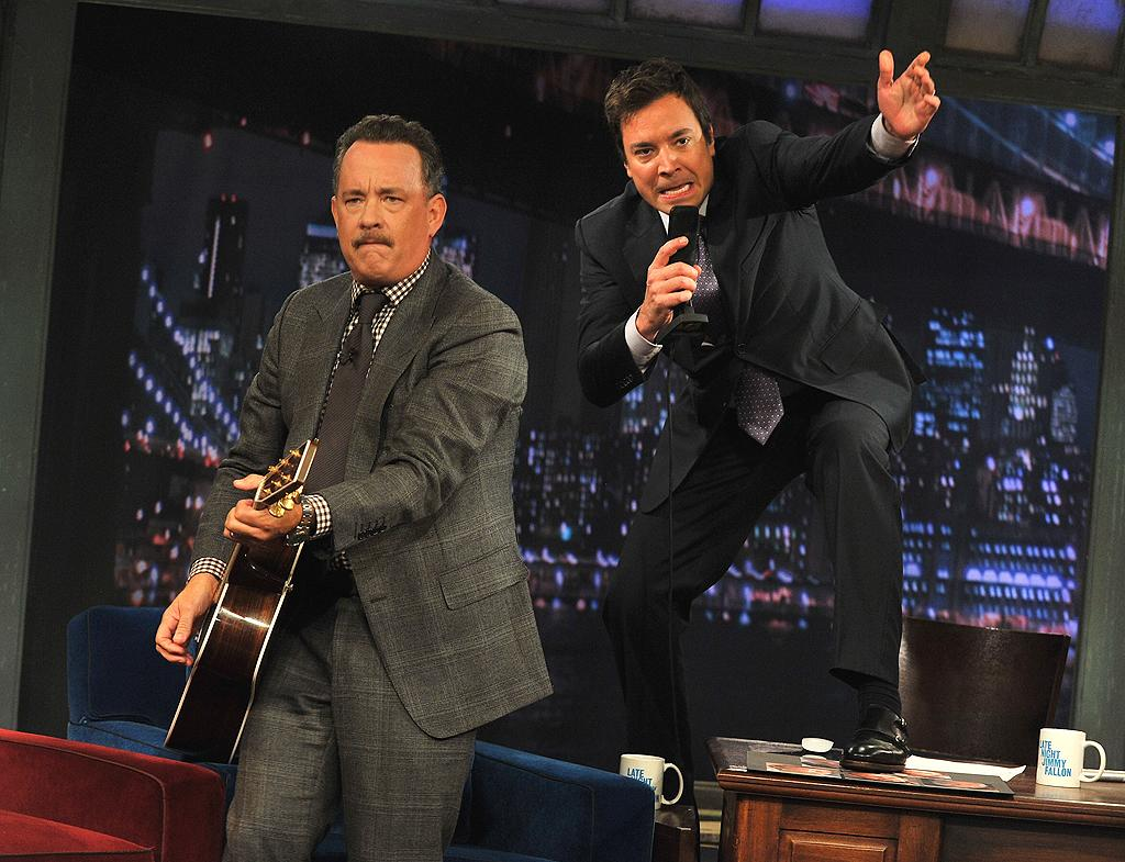 """The may not have the smooth voice that Bruce Springsteen does, but Tom Hanks and Jimmy Fallon gave it their all when they teamed up for a rendition of The Boss's """"Wrecking Ball"""" on """"Late Night With Jimmy Fallon"""" Tuesday night. (10/23/2012)"""