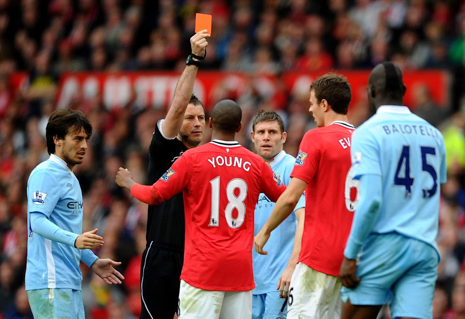 Johnny Evans is sent off against Manchester City and United go on to lose 6-1. United then lose the title on goal difference. Should Evans have been sent off? (23 October 2011)