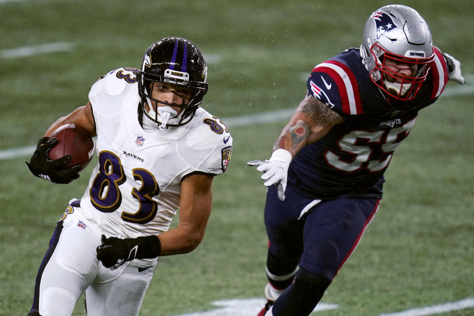 Baltimore Ravens wide receiver Willie Snead IV, left, eludes New England Patriots defensive end John Simon as he runs for a touchdown in the first half of an NFL football game, Sunday, Nov. 15, 2020, in Foxborough, Mass. (AP Photo/Charles Krupa)