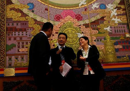 People chat ahead of a Tibet Autonomous Region group discussion session during China's National People's Congress in Beijing