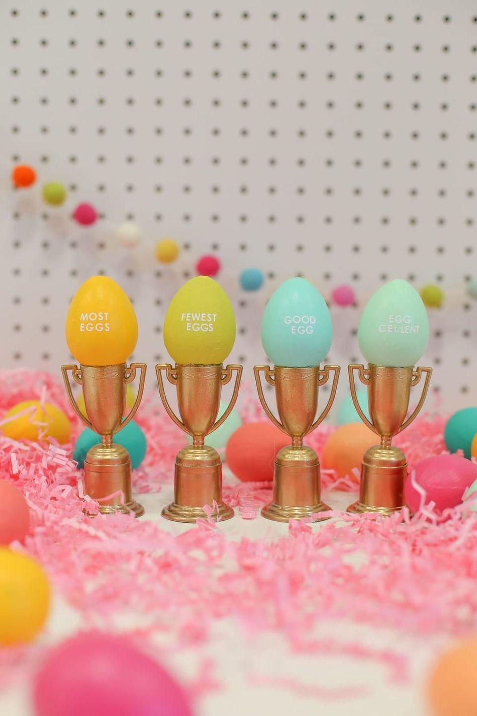 """<p>Sure, chocolate is the <em>actual</em> trophy when it comes to Easter egg hunts. But an additional real one doesn't hurt!</p><p><strong>Get the tutorial at <a href=""""https://lovelyindeed.com/make-these-tiny-trophies-for-your-easter-egg-hunts/"""" rel=""""nofollow noopener"""" target=""""_blank"""" data-ylk=""""slk:Lovely Indeed"""" class=""""link rapid-noclick-resp"""">Lovely Indeed</a>.</strong></p><p><strong><a class=""""link rapid-noclick-resp"""" href=""""https://www.amazon.com/Juvale-Award-Trophies-Tournaments-Competitions/dp/B077HFZH4T/ref=sr_1_5?dchild=1&keywords=small+trophies&qid=1614112746&sr=8-5&tag=syn-yahoo-20&ascsubtag=%5Bartid%7C10050.g.4083%5Bsrc%7Cyahoo-us"""" rel=""""nofollow noopener"""" target=""""_blank"""" data-ylk=""""slk:SHOP TROPHIES"""">SHOP TROPHIES</a><br></strong></p>"""