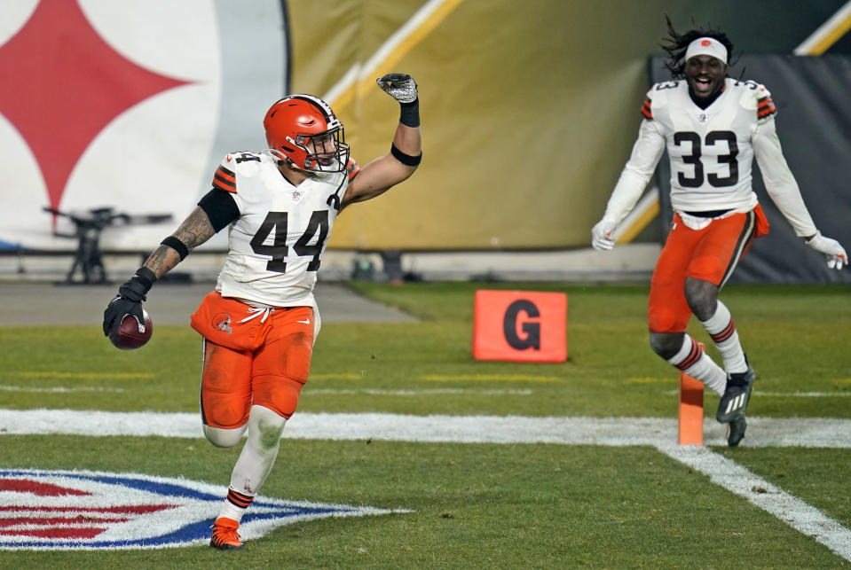 Cleveland Browns outside linebacker Sione Takitaki (44) celebrates after intercepting a pass by Pittsburgh Steelers quarterback Ben Roethlisberger (7) during the second half of an NFL wild-card playoff football game, Sunday, Jan. 10, 2021, in Pittsburgh. (AP Photo/Keith Srakocic)