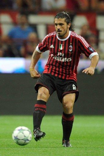 AC Milan's midfielder Gennaro Ivan Gattuso passes the ball during the Trophee Luigi Berlusconi match AC Milan against Juventus, in August 2011, at San Siro stadium in Milan. Gattuso, Filippo Inzaghi and Alessandro Nesta will end their AC Milan careers against Novara on Sunday as the end of an era is all but completed at the San Siro