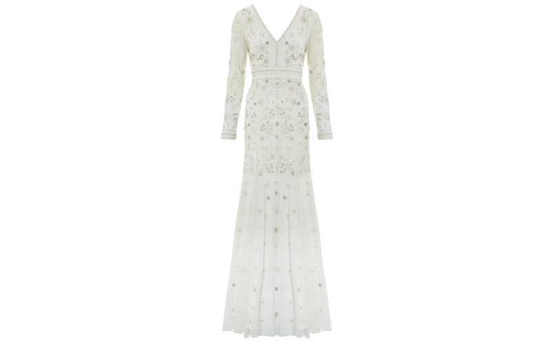 """<p>With a sweeping train, princess-worthy neckline and delicate embellishment – this is one for the bride who isn't looking for minimal. <a rel=""""nofollow noopener"""" href=""""https://uk.monsoon.co.uk/view/product/uk_catalog/mon_40,mon_40.1/6402054606"""" target=""""_blank"""" data-ylk=""""slk:Shop now"""" class=""""link rapid-noclick-resp""""><em>Shop now</em></a>. </p>"""