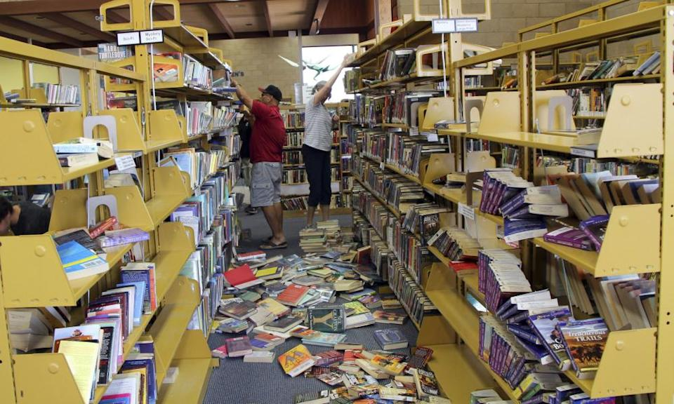 Volunteers assist with cleanup at the Ridgecrest, California, branch of the Kern County Library following the California earthquake.