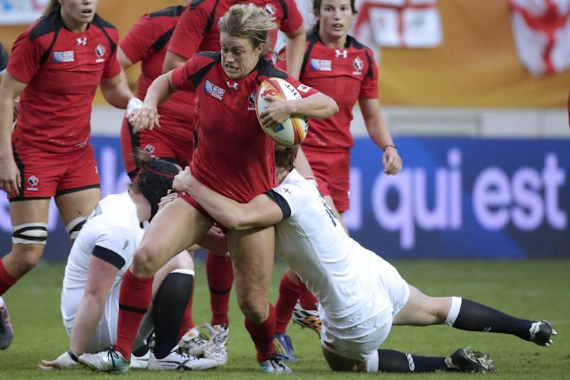 Canada's centre Andrea Burk runs with the ball during the IRB Women's Rugby World Cup final match between England and Canada at the Jean Bouin Stadium on August 17, 2014 in Paris (AFP Photo/Kenzo Tribouillard )
