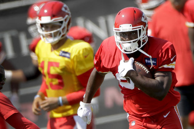 Kansas City Chiefs running back LeSean McCoy, right, runs the ball during NFL football practice at the team's training facility Wednesday, Sept. 4, 2019, in Kansas City, Mo. (AP Photo/Charlie Riedel)