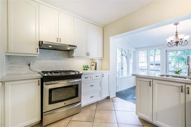 <p><span>97 Queens Dr., Toronto, Ont.</span><br> The renovated kitchen has quartz countertops and stainless steel appliances.<br> (Photo: Zoocasa) </p>
