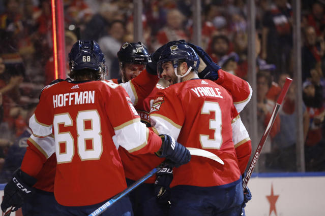 Florida Panthers defenseman Keith Yandle (3) celebrates after left wing Mike Hoffman (68) scored during the second period of an NHL hockey game against the Vancouver Canucks, Thursday, Jan. 9, 2020, in Sunrise, Fla. (AP Photo/Brynn Anderson)
