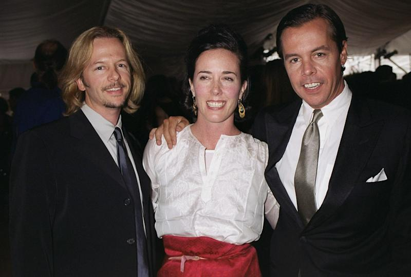Kate Spade is flanked by her husband, Andy Spade (right) and brother-in-law David Spade at the American Fashion Awards in New York in 2000. (New York Daily News Archive via Getty Images)